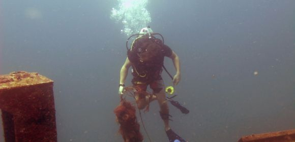 A diver near the coast of Sri Lanka collecting so-called ghost nets, lost fishing equipment that litters the ocean.