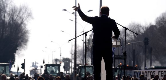 Thessaloniki, Greece - February 1, 2018. The silhouette of a farmer is seen, as he holds a speech during a farmers protest against their income cuts