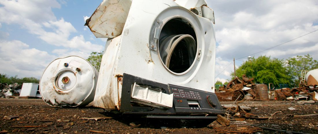 Old household appliances disposed of in metal scrapyard