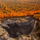 Strip mine in the midst of a forest