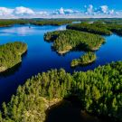 Aerial view of blue lakes and green forests on a sunny summer day in Finland. drone photography