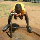 Boy with running water