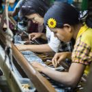Mandalay Myanmar - Dec 2016: Visiting the silk weaving center, where skillful workers were producing premium hand-made grade goods