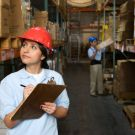 Woman in storage area of warehouse