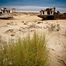 The beached ships of Aral Sea at Moynaq, once a vibrant fishing port.  The ships now stand more than 150km from the water.  They are sobering symbols of an ecological disaster of tragic proportion.  