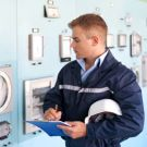 Technician examines energy management for EMAS