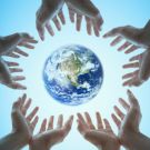 Planet earth floating over human hands