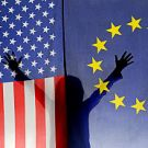 Silhouette of girl (6-7) waving hands behind US and European Union flags
