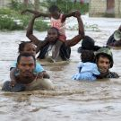 Jordanian UN peacekeepers rescue children from an flooded orphanage some 20 kilometres north of Port au Prince after the passing of hurricane Ike