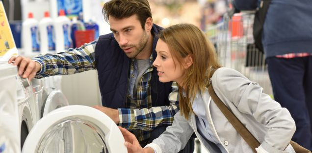 Caucasian couple considering to purchase a new washing machine