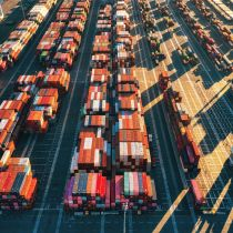 Aerial view of colourful shipping containers in a harbour.