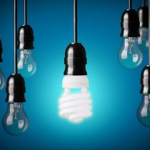 Energy saving and simple light bulbs.Blue background