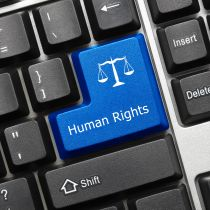 Close-up view on a conceptual keyboard - the enter key says Human Rights