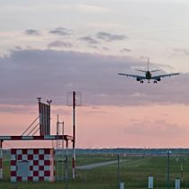 Airplane landing, low angle view, rear view