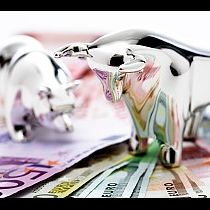 Bull and bear figurine on euro banknotes, close-up